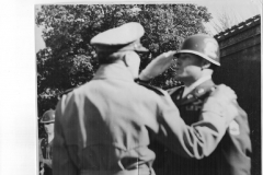 Fred C. May saluting General MacArthur
