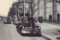 Embassy vehicles, and General's Cadillac in front of Dai Ichi building.