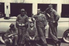 Col. Huff's Dodge convertible. (L-R) Driver; J.C. Wright - Guard; Stikes - mechanic; E. Moore - mechanic & welder; R. Bagschmidt